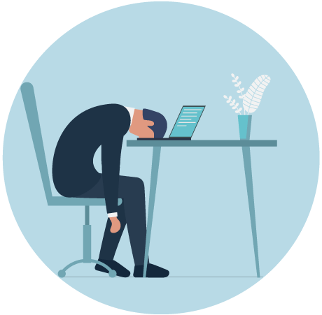 Man slumped on his desk from frustration with a laptop open