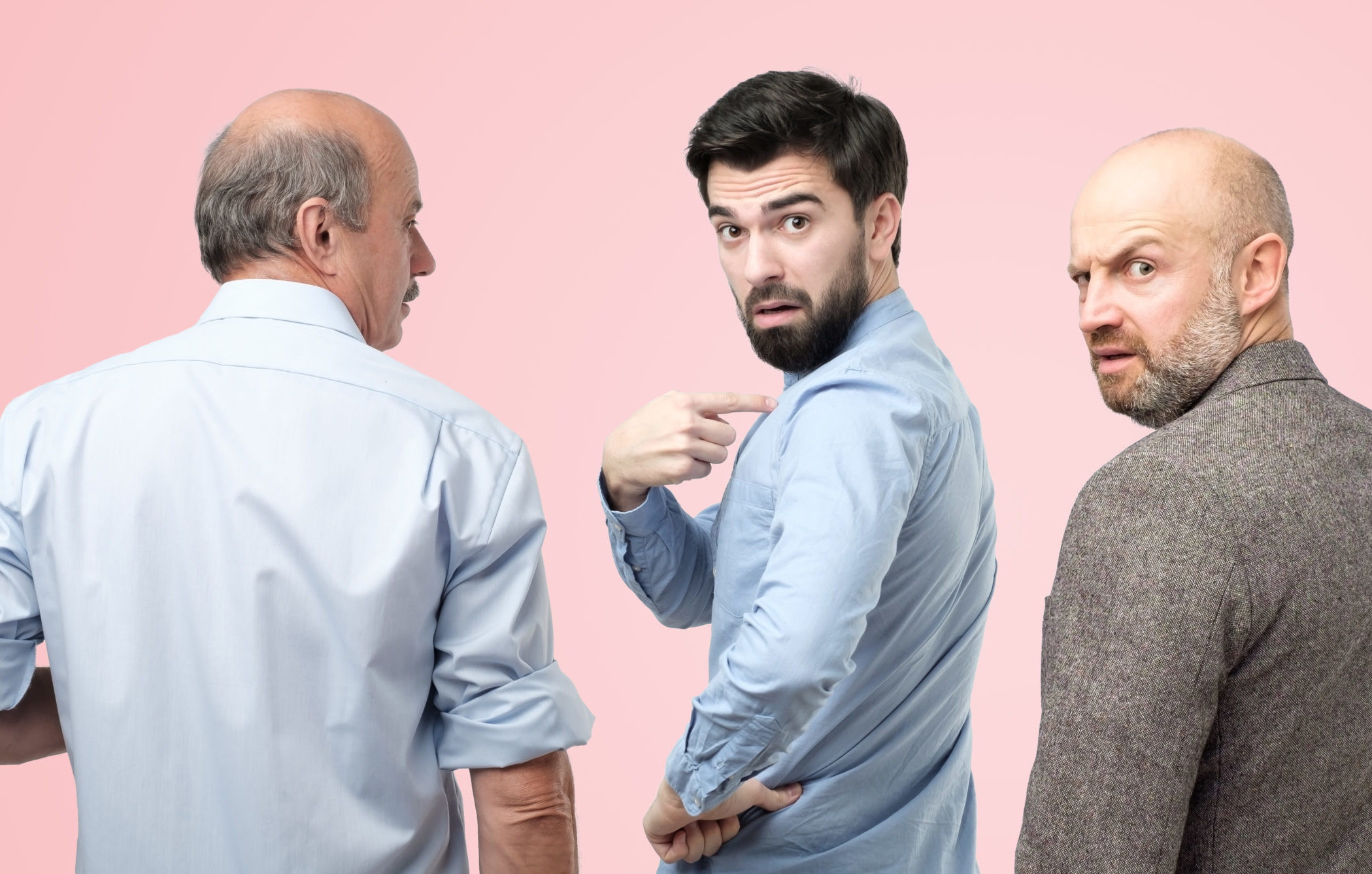 Several people standing and talking animatedly representing unsettled employees as a result of IT project poorly managed